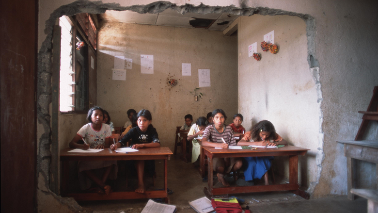 East Timor Student in a war torn classroom